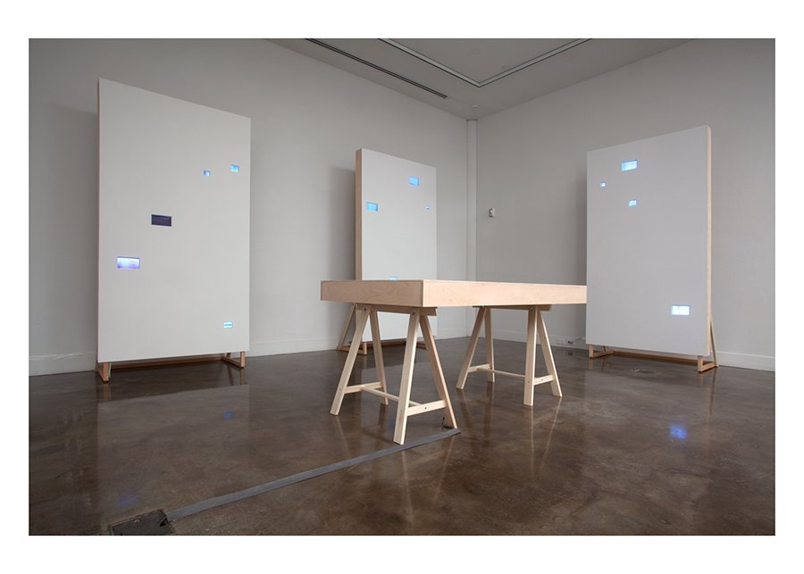 Apophenia, 17 single channel videos, monitors on 4 wood surfaces, sound: Sean Regan, 2011