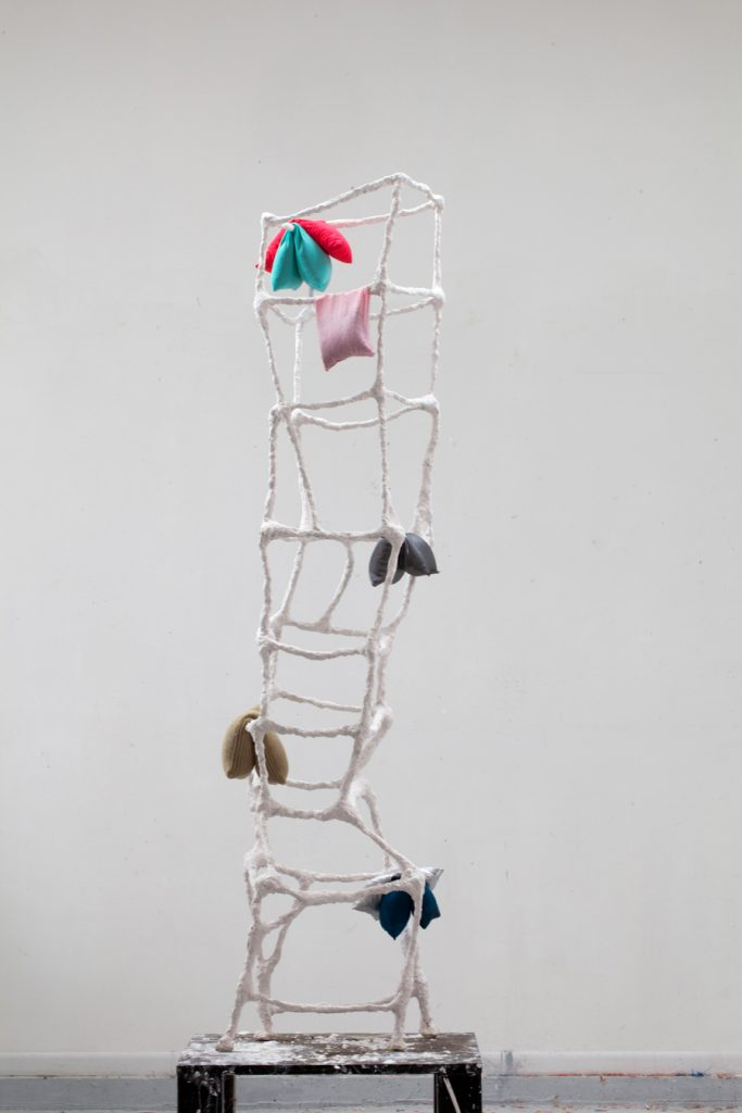 "Shouldup (alt. view), metal, plaster, fabric, buckwheat hulls, 76""x 20"" x20"", 2015"